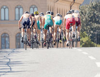 Rear view of a group of triathlete cyclists Royalty Free Stock Photography