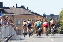 Rear view of a group of triathlete cyclists Stock Photo
