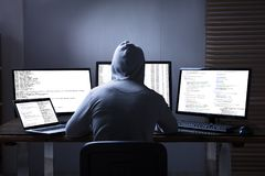 Hacker Using Multiple Computers For Stealing Data stock photos