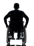 Rear view handicapped man in wheelchair silhouette Stock Photography
