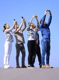 Rear view. happy friends doing a selfie. Royalty Free Stock Photos