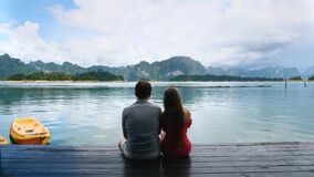 Rear View of Happy Romantic Couple Sit Together on Anniversary Date in Nature