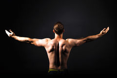 Rear view of healthy muscular young man royalty free stock photo