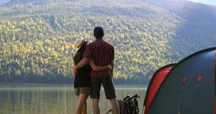 Hiker couple standing near riverside 4k stock video