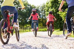 Rear View Of Hispanic Family On Cycle Ride Stock Images