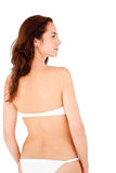 Rear view of a hispanic woman wearing white bikini Stock Photos
