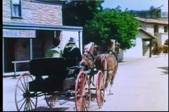 Rear view of horse carriage passing by general store stock footage