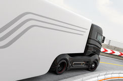 Rear view of hybrid electric truck on highway Stock Photos