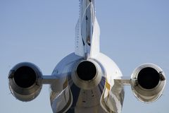 Rear view of jet airplane Stock Photos