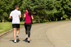 Rear view of jogging caucasian couple. Outdoors stock images