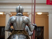 Rear view of a knight wearing 16th century German plate armor while holding a lance stock photography