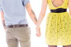 Rear view of a lesbian couple standing with holding hands Stock Photography