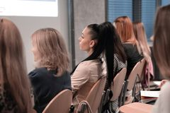 Rear view.the listeners sitting in the conference room. Close up royalty free stock photography