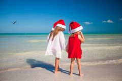 Rear view of Little cute girls in Christmas hats Royalty Free Stock Photo