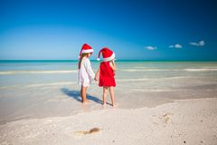 Rear view of Little cute girls in Christmas hats Stock Photo