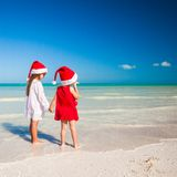 Rear view of Little cute girls in Christmas hats Royalty Free Stock Photography