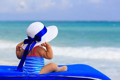 Rear view of little girl in big hat on summer Royalty Free Stock Image