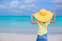 Rear view of little girl in a big yellow straw hat Royalty Free Stock Photography
