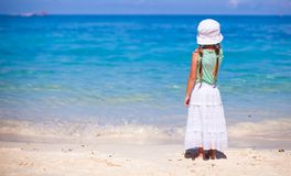 Rear view of little girl in hat looking at the sea Royalty Free Stock Photo