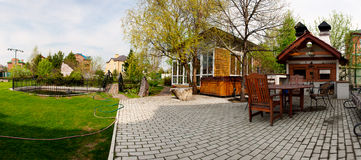 Rear view of luxury home backyard. With swimming pool, patio and lawn royalty free stock image