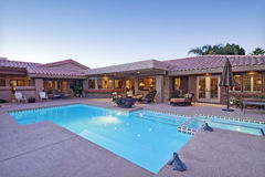 Rear view of luxury villa with swimming pool stock photography