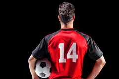 Rear view of male athlete holding football Royalty Free Stock Image