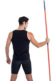 Rear view of male athlete holding javelin Royalty Free Stock Images