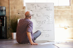 Rear View Of Male Designer Drawing Flow Chart Royalty Free Stock Photo