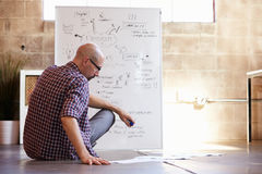 Rear View Of Male Designer Drawing Flow Chart Royalty Free Stock Image