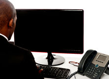 Rear view of male executive working on pc Royalty Free Stock Photography