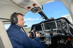 Rear view male helicopter pilot stock photo