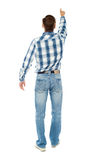 Rear view of a male indicating towards copy space Royalty Free Stock Photos