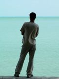 Rear view of man. Man standing on seashore Royalty Free Stock Photos