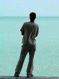 Rear view of man. Man standing on seashore royalty free stock photos