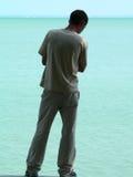 Rear view of man. Man standing on seashore stock image
