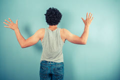 Rear view of man with arms raised Royalty Free Stock Photos