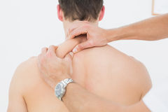 Rear view of a man being massaged by a physiotherapist Stock Photos