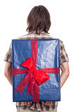 Rear view of man with big present Stock Photography