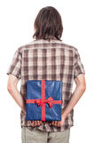 Rear view of man with blue present Royalty Free Stock Photography