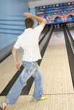 Rear View Of A Man Bowling Royalty Free Stock Images