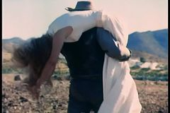 Rear view of a man carrying woman on his back through rocky terrain stock video footage