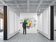 Rear view of a man drawing a sketch in an art gallery Royalty Free Stock Images