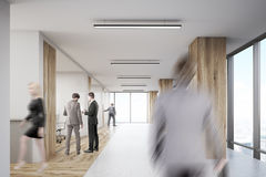 Rear view of man entering office with wooden columns Stock Images