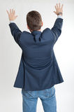 Rear view of man extending his hands Royalty Free Stock Images