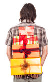 Rear view of man with gifts Royalty Free Stock Photo
