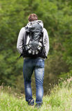 Rear View Of Man Hiking In Countryside Stock Photo