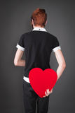 Rear view - man holding heart for love Royalty Free Stock Images