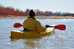 Rear view of man in kayak Stock Photos