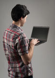 Rear view of a man with laptop Royalty Free Stock Images