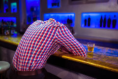 Rear view of man lying on bar counter Royalty Free Stock Photo